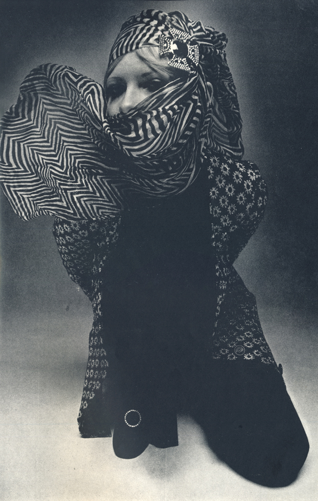 Trouser suit and black lurex roll neck sweater designed by Sonia Rykiel. Both from The Shop, Vidal Sassoon, Sloane Street. Scarf from Suna's Shop, 47 Radnor Walk.