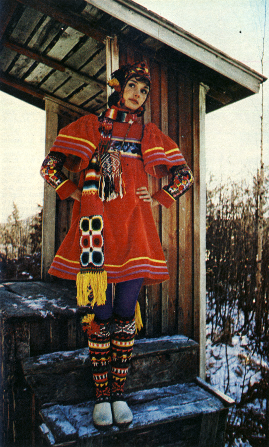 Red velvet smock by Jap and socks, helmet, armbands, bag and scarf from Inca