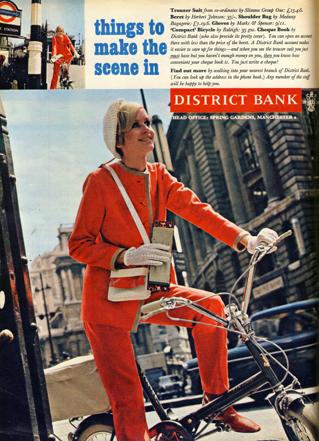 Trouser suit by Slimma Group One, hat by Herbert Johnson, gloves by Marks and Spencer, 'Compact' bicycle by Raleigh, cheque book by District Bank