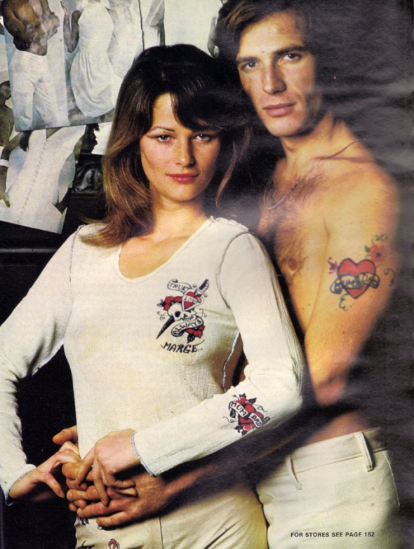 How to be tatooed while staying a lady. Charlotte has the art in this cheesecloth t-shirt and leather trousers. Tattoos turn a lot of men on - but if not you can just slip this lot off. By Henry Miura.