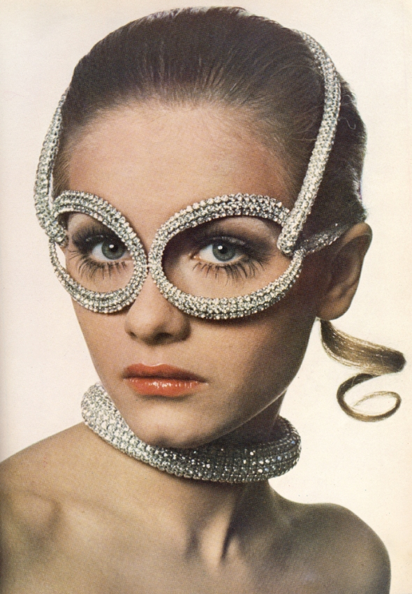 Rhinestone spectacles and collar are by Halston of New York