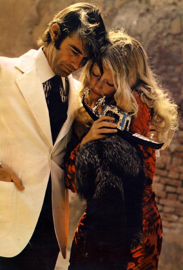 Lui: Jacket by Harry Lans from Printemps Brummell. Shirt and tie by Francesco Smalto. Trousers by Brummell. Elle: Dress by Ossie Clark. Silver fox fur by Robert Beaulieu.