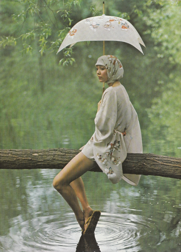 ...in a leafy glade - the green and woody scent of Coty's Emeraude. Short beige silk kimono, £35, scarf, £8, printed with figures by Kansai Yamamoto, matching umbrella by Kanei Orimono, £5 from Boston-151.