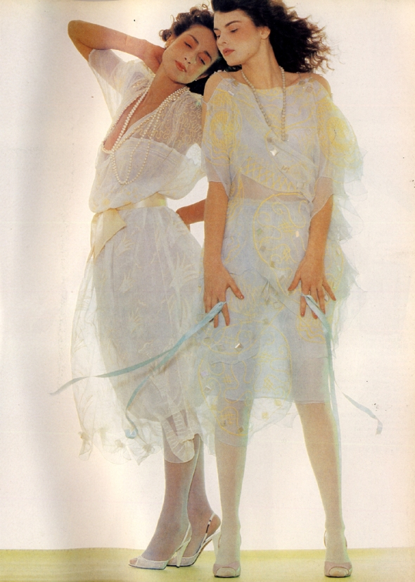 Hand-printed silk dresses by Zandra Rhodes. White net shoes from Midas. Lilac leather shoes by Karl Lagerfeld from Chloe.