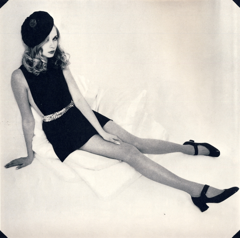 Square necked sideless dress by Ginger Group. Gold link belt by Paris House. Black patent shoes by Kurt Geiger. Satin beret by Rudolf.