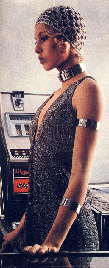 Lurex jersey dress, memorably low-cut, by Janice Wainwright for Simon Massey. Pale silver crochet hat from Ritva.