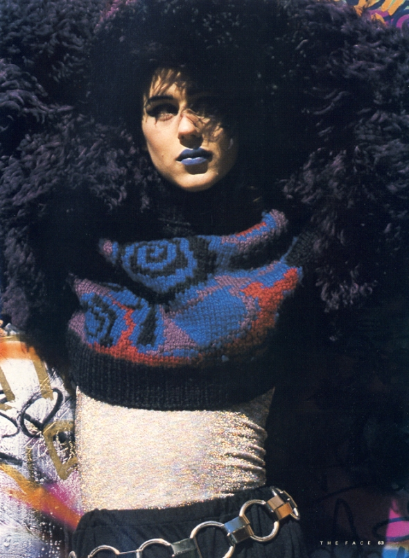 Fun fur purple sheepskin jacket and hat, with motif sweater and black jersey flares all by Helen Storey of Amalgamated Talent available from Academy, 188a Kings Road, London. Belt from Prism at Hyper Hyper.