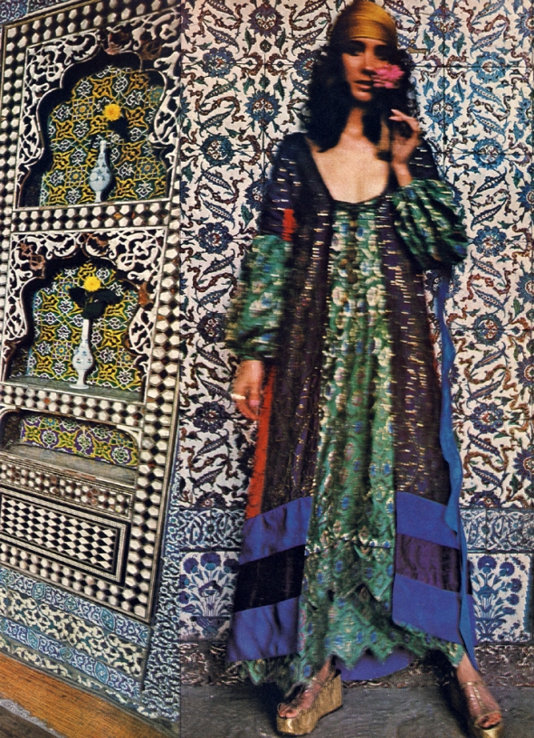 In the harem, green brocade with sleeves coming through and a pointed petal hem worn under Turkish evening blue - a coat the colour of the electric moment, panelled in scarlet and midnight and violet, flying pinked blue streamers. All to order at Thea Porter. Platform sandals by Andrea Pfister.