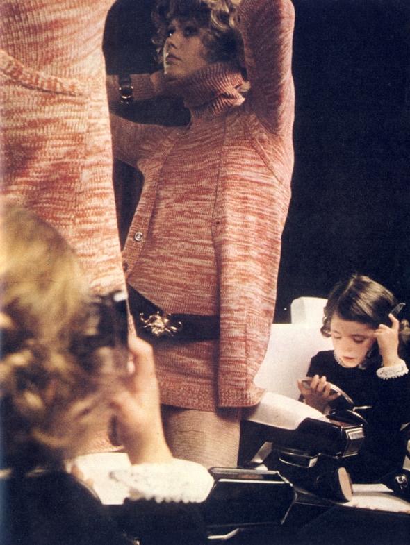 Marled knit polo neck sweater with sleeveless waistcoat by Biba. Leather belt by Cerruti.