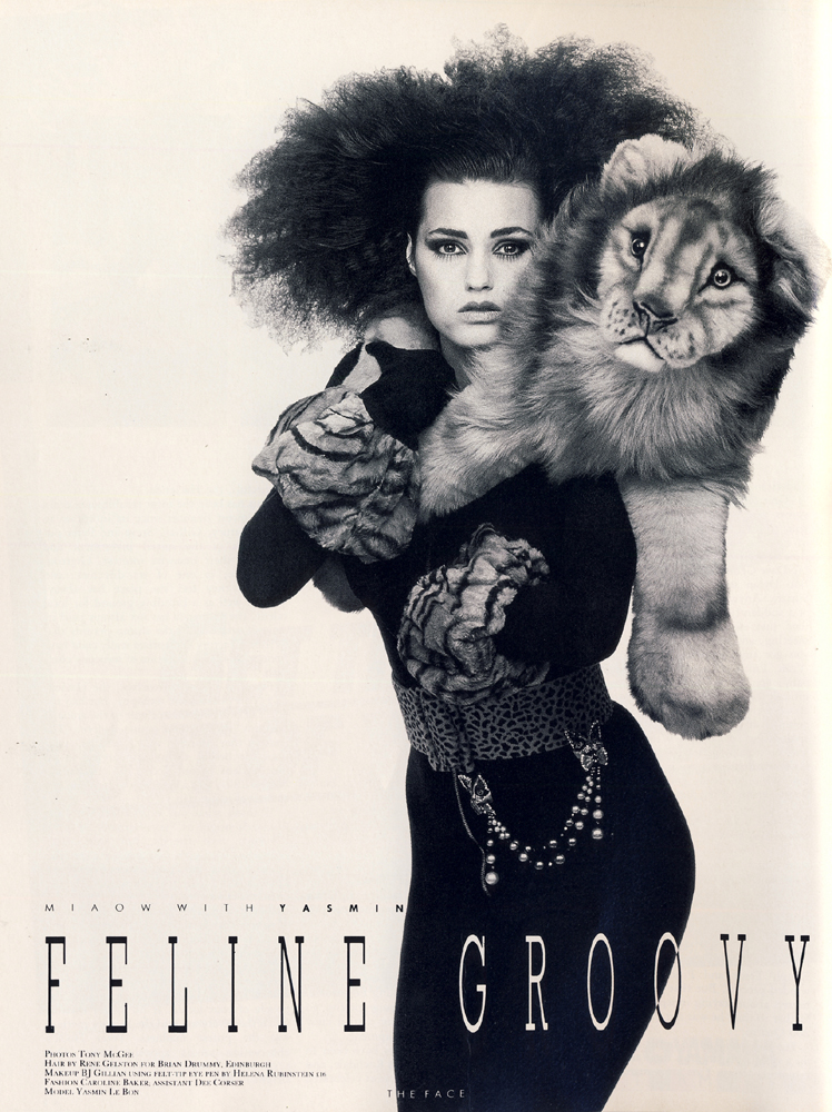 Black lycra catsuit by Katharine Hamnett. Gauntlets by Norma Kamali. Lion from Harrods. Cat brooches at Merola. Belt by Vanessa Schon.