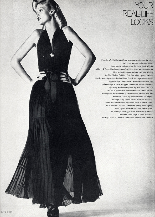 Navy chiffon pleats, sashed with navy ribbon, by Roland Klein at Marcel Fenez. Black leather shoes by Mary Quant.