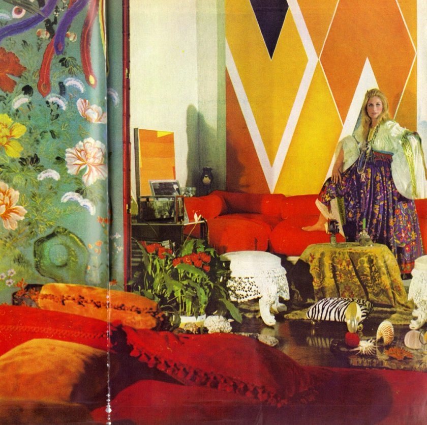 The living room with Jane Holzer in gipsy dress with ribbon-swagged sleeves and wildly flowered skirt by Sant'Angelo; an 18th-century Chinese screen, thirteenfoot high and covered with precious bird and flower paper; white iron lace stools first ordered by Queen Victoria from her Indian Empire; Larry Zox's vast 1968 abstract; a low table of polished petrified wood with a collection of coral and sea creatures shells, and, in front, Mrs Holzer's own design for the sofa, several suede pillows thrown accurately at random.