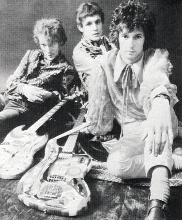 The Cream with their instruments, painted by Simon and Marijke.