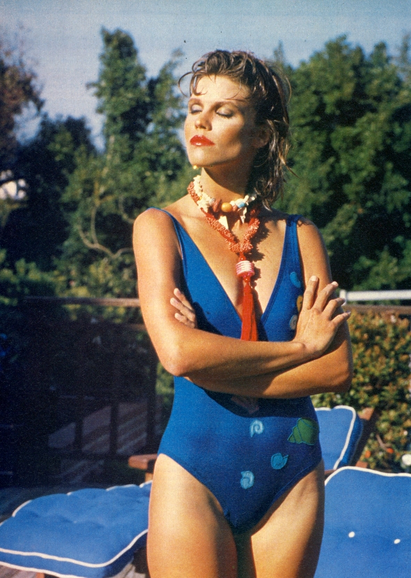 b01d2f0b0b9 Blue one-piece with shell applique by Susan Backhouse. Bone necklace from  Bombacha.